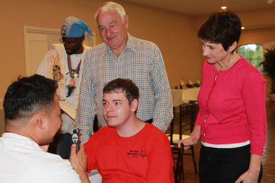 Tom Golisano, Paychex founder, philanthropist and father of a son with intellectual disability, gifts $30 million to Special Olympics to Expand Critical Health Services Globally for People with Intellectual Disabilities. Tom Golisano and Golisano Foundation Executive Director Ann Costello observe an eye screening at an event before the pandemic.